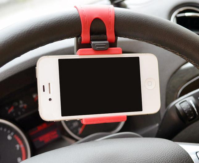 Steering wheel phone-holder