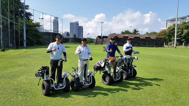 Golfers on board Segway PH's modified i2 SE