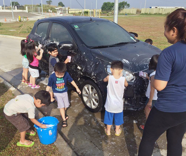Children washing a car