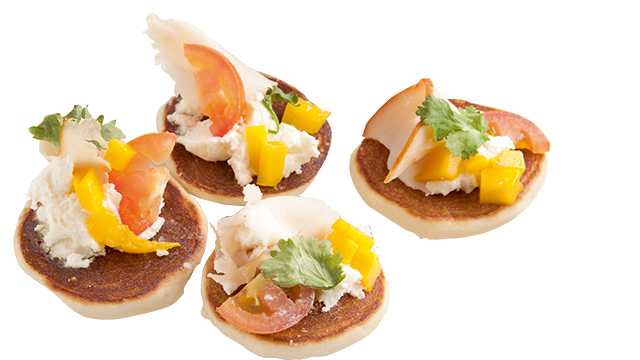 Mini pancakes like these can be used as part of party appetizers.