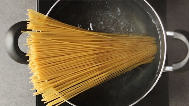 The dried pasta noodles will soften as the water boils, so there's no need to break the noodles.