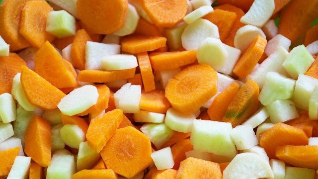These chopped carrots are ready to add to the hot pan.