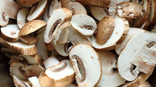 These sliced white button mushrooms are ready to be cooked.