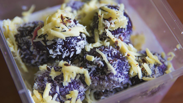 Palitaw stuffed with ube and cheese is a delicious kakanin treat!