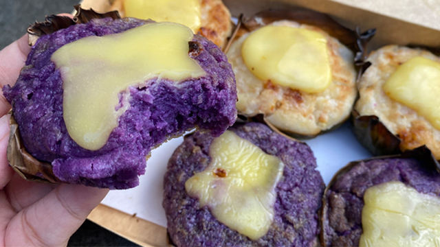 These baked ube rice cakes are topped with a gooey melted cheddar cheese.