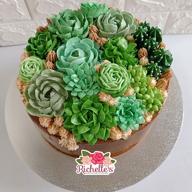 These succulents made of buttercream make pretty and edible decorations for this cake.
