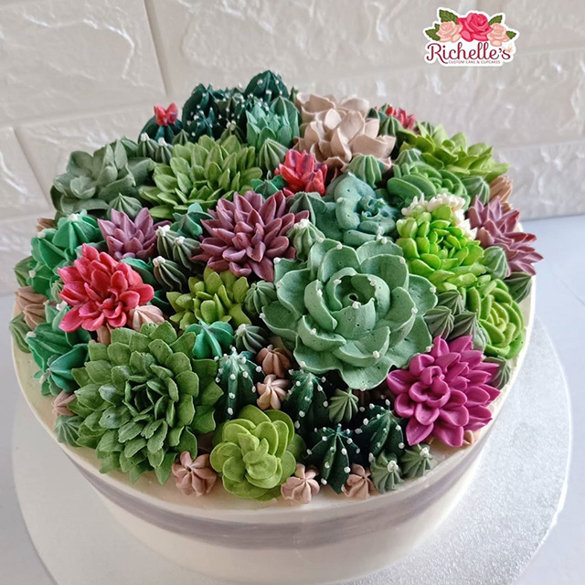 It's hard to resist slicing into a bouquet of edible flowers such as these on top of this pretty cake.