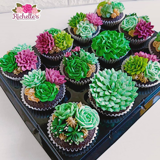 These cupcakes are topped with buttercream frosting made to look like flowering succulents and cacti.